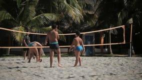 VARADERO, CUBA - DECEMBER 23, 2011: Kids playing beach volleyball stock footage