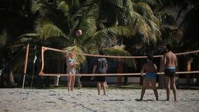 VARADERO, CUBA - DECEMBER 23, 2011: Kids playing beach volleyball stock video