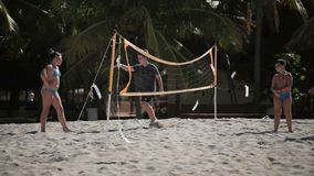 VARADERO, CUBA - DECEMBER 23, 2011: Kids playing beach volleyball. At sunny day stock video footage