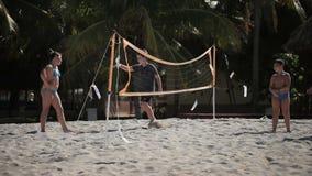 VARADERO, CUBA - DECEMBER 23, 2011: Kids playing beach volleyball stock video footage