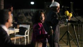 VARADERO, CUBA - DECEMBER 23, 2011: Music band outdoors. VARADERO, CUBA - DECEMBER 23, 2011 Music band outdoors at night stock video