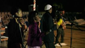 VARADERO, CUBA - DECEMBER 23, 2011: Music band outdoors. VARADERO, CUBA - DECEMBER 23, 2011 Music band outdoors at night stock footage