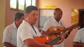 VARADERO, CUBA - DECEMBER 22, 2011: Musicians playing music. VARADERO, CUBA - DECEMBER 22, 2011 Musicians playing music indoors stock footage