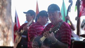 VARADERO, CUBA - DECEMBER 22, 2011: Musicians playing music. Outdoors at sunny day stock video footage