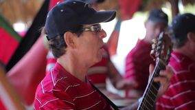 VARADERO, CUBA - DECEMBER 22, 2011: Musicians playing music. Outdoors at sunny day stock footage