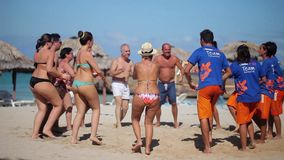 VARADERO, CUBA - DECEMBER 23, 2011: People dancing synchronous. At the beach stock video footage