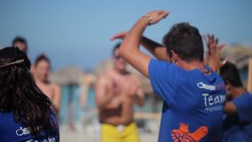 VARADERO, CUBA - DECEMBER 23, 2011: People dancing synchronous. At the beach stock video