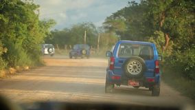 VARADERO, CUBA - DECEMBER 23, 2011: SUV cars on a coutry road stock footage