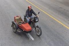 VARADERO, CUBA - JANUARY 05, 2018: Classic motorcycle with strol. Ler rides on the road of Varadero in Cuba Stock Photography