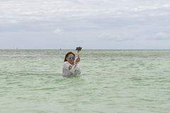 VARADERO, CUBA - JANUARY 06, 2018: A woman in cold water leaves Stock Photography