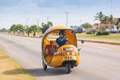 Varadero, Cuba - November, 2018: Yellow coco taxi driving on the street in Varadero, Cuba royalty free stock photo