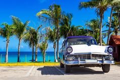 American blue white 1956 vintage car parked direct on the beach in Havana Cuba - Serie Cuba. American blue white Ford Fairlane vintage car parked on the beach in stock image