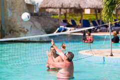 VARADERO, MATANZAS, CUBA - MAY 18, 2017: People play volleyball in the pool. Copy space for text. VARADERO, MATANZAS, CUBA - MAY 18, 2017: People play Royalty Free Stock Image
