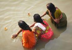 VARANASI - 6 NOVEMBER: Hindu people. Wash themselves in the river Ganga in the holy city of Varanasi.  The holy ritual of washing is held every day -Varanasi Royalty Free Stock Photos
