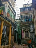 Varanasi (Benares - India). Narrow street in the sacred and spiritual city of Varanasi, India Stock Photos