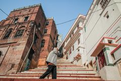A passer-by on the ghats of Varanasi, Uttar Pradesh, India. Varanasi is a city in the northern Indian state of Uttar Pradesh dating to the 11th century B.C Stock Photos