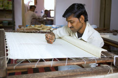 VARANASI, INDIA � DEC 9, 2013: Unidentified Indian man embroider Royalty Free Stock Photos