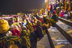 People in the night in Varanasi in religious washing ceremony. VARANASI - INDIA, DECEMBER 10: Hindu people wash themselves in the river Ganga in the holy city of Stock Images