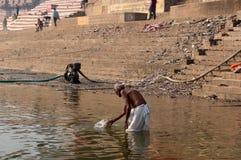 VARANASI, INDIA - December 26, 2014: Laundry in holy Ganges river, Varanasi, India Stock Image