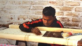 Varanasi, india, embroiderer at work stock video footage