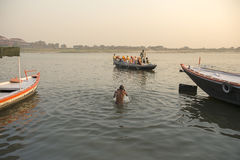 VARANASI INDIA  07 FEB 2013 :early morning indian people come to holy dip at Ghat near ganga river Stock Photo