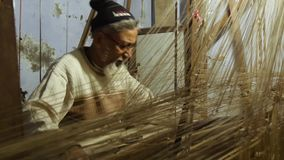 Varanasi, india, indian weaver at work. Portrait of an Indian artisan in his workplace stock footage