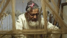 Varanasi, india, indian weaver at work stock video footage