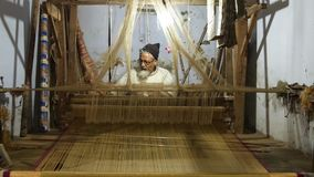 Varanasi, india, indian weaver at work. Portrait of an Indian artisan in his workplace stock video footage