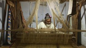 Varanasi, india, indian weaver at work. Portrait of an Indian artisan in his workplace stock video