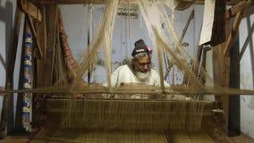 Varanasi, india, indian weaver at work stock video