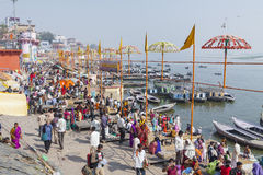 VARANASI, INDIA - JANUARY 26, 2012: Ghats on the banks of Ganges. River in holy city of Varanasi Stock Photos