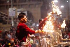 VARANASI, INDIA- 23 JANUARY 2017 : A Hindu priest performs the G Stock Photos