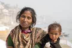 Portrait mother and children on the street in Varanasi, India. VARANASI, INDIA - JANUARY 26, 2017 : Portrait mother and children on the street at the ghats of Stock Image