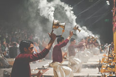 VARANASI, INDIA - JANUARY 25, 2017: Waving Kapoor lamps. Crowds Stock Photography