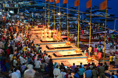 Ganga Maha Aarti ceremony fire puja. Varanasi, India - Jul 12, 2015. Indian Brahmins conducts religious Ganga Maha Aarti ceremony fire puja at Dashashwamedh Ghat Stock Photos