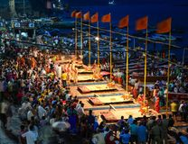Fire ceremony on riverbank in Varanasi, India. Varanasi, India - Jul 11, 2015. Indian Brahmins conducts religious Ganga Maha Aarti ceremony fire puja at Royalty Free Stock Photo