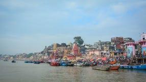 Ghats on Ganges riverbank in Varanasi, India. Varanasi, India - Jul 12, 2015. View of the riverbank of Ganges under blue sky in Varanasi, India. Varanasi draws royalty free stock photo