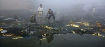 Varanasi. India - Varanasi - Manikarnika ghat - cremation of cadaver royalty free stock image