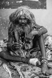 Hindu sadhu on the ghats of the Ganges river. Royalty Free Stock Photos