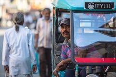 Indian trishaw waiting passengers on the street. VARANASI, INDIA - MAR 21, 2018: Indian trishaw waiting passengers on the street. According to legends, the city Stock Photo