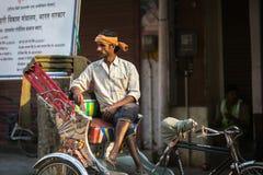Indian trishaw waiting passengers on the street. VARANASI, INDIA - MAR 23, 2018: Indian trishaw waiting passengers on the street. According to legends, the city Stock Photo