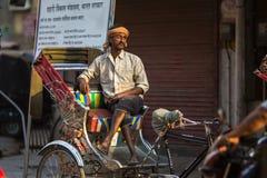 Indian trishaw waiting passengers on the street. VARANASI, INDIA - MAR 23, 2018: Indian trishaw waiting passengers on the street. According to legends, the city Stock Image