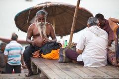 Pilgrims expect ritual Agni Pooja Sanskrit: Worship of Fire on Dashashwamedh Ghat Royalty Free Stock Photos