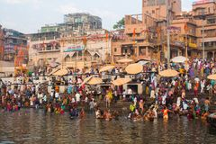 Pilgrims plunge into the water holy Ganges river in the early morning. VARANASI, INDIA - MAR 22, 2018: Pilgrims plunge into the water holy Ganges river in the royalty free stock photos