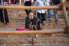 Sadhu or Baba holy man on the ghats of Ganges river. Royalty Free Stock Photos