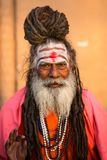 Sadhu or Baba holy man on the ghats of Ganges river. Royalty Free Stock Photo