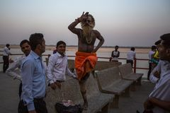 Sadhu or Baba holy man on the ghats of Ganges river. Royalty Free Stock Images
