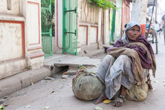 Beggar woman in streets of Varanasi Stock Photos