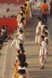 Young hindu priests doing a parade at riverside of Ganges in Varanasi, Uttar Pradesh, India. Varanasi, India - March 25, 2017, Parade of young hindu priests at royalty free stock image