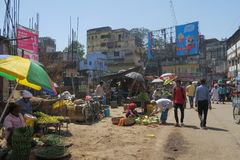 Market street scene in Varanasi, Uttar Pradesh with colorful umbrellas and lots of people stock photos
